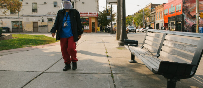 Photographed in Parkdale, a man protects his face twice by covering it with a face mask and a face shield. In these times, maintaining a normal life and carrying on with a routine takes courage and resilience. How do you work around fear to start leading a somewhat normal life as we transition into life post-quarantine? Photo: Ebti Nabag.